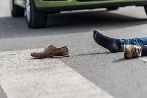 905971060 istock photo Traffic accident.Young man hit by a car 650707538