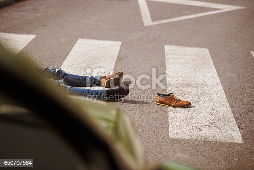 905971060istockphoto Traffic accident.Young man hit by a car 650707564