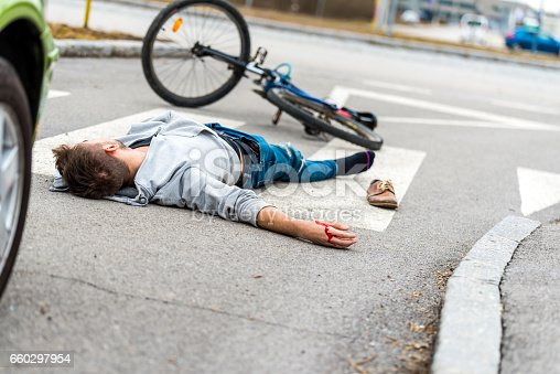 905971060istockphoto Traffic accident.Young man hit by a car 660297954