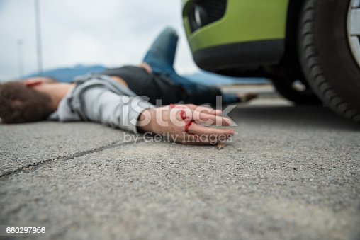 905971060istockphoto Traffic accident.Young man hit by a car 660297956