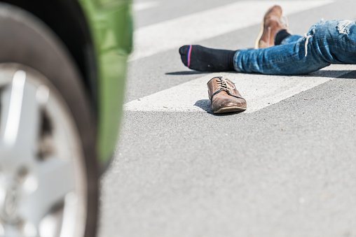 905971060 istock photo Traffic accident.Young man hit by a car 901898540