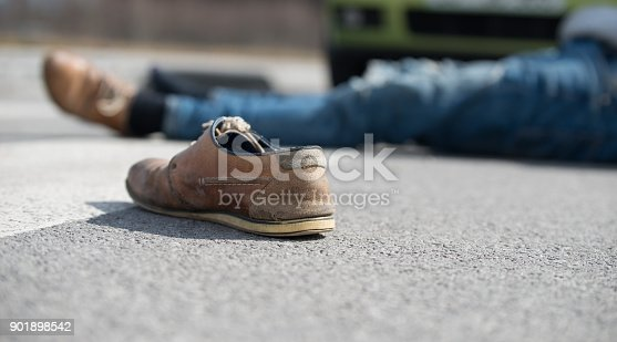 905971060istockphoto Traffic accident.Young man hit by a car 901898542