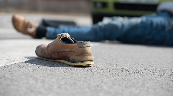 905971060 istock photo Traffic accident.Young man hit by a car 901898542