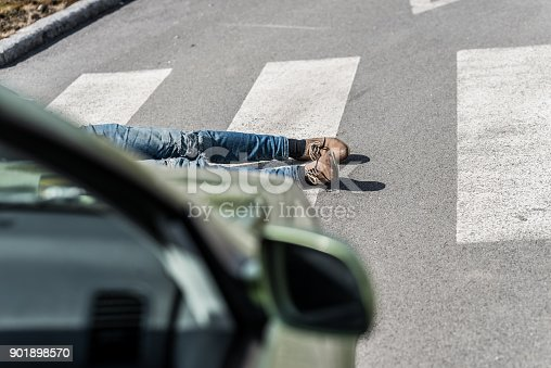 905971060istockphoto Traffic accident.Young man hit by a car 901898570