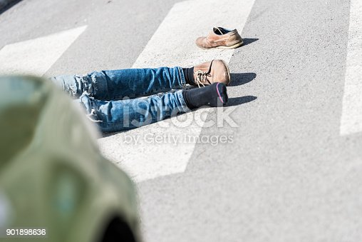 905971060istockphoto Traffic accident.Young man hit by a car 901898636