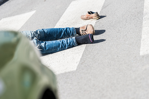 905971060 istock photo Traffic accident.Young man hit by a car 901898638