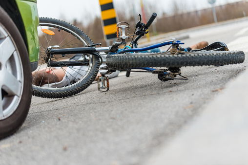905971060 istock photo Traffic accident.Young man hit by a car 901908638