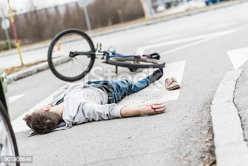 905971060istockphoto Traffic accident.Young man hit by a car 901908646