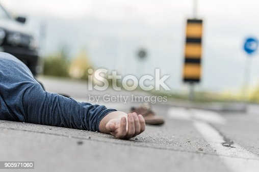 istock Traffic accident.Young man hit by a car 905971060