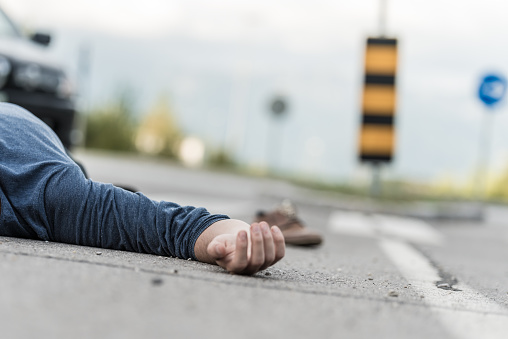 905971060 istock photo Traffic accident.Young man hit by a car 905971060