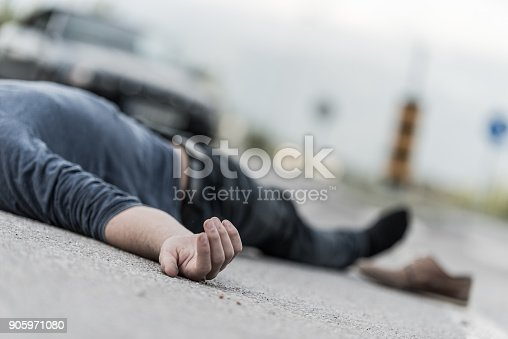905971060istockphoto Traffic accident.Young man hit by a car 905971080