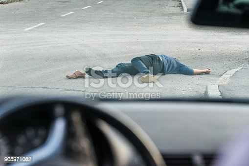 905971060istockphoto Traffic accident.Young man hit by a car 905971082