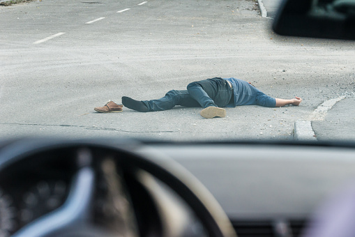 905971060 istock photo Traffic accident.Young man hit by a car 905971082