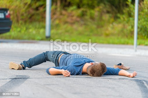 905971060istockphoto Traffic accident.Young man hit by a car 905971084