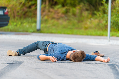 905971060 istock photo Traffic accident.Young man hit by a car 905971084
