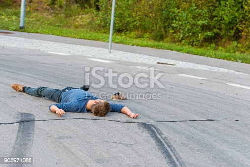 905971060istockphoto Traffic accident.Young man hit by a car 905971088