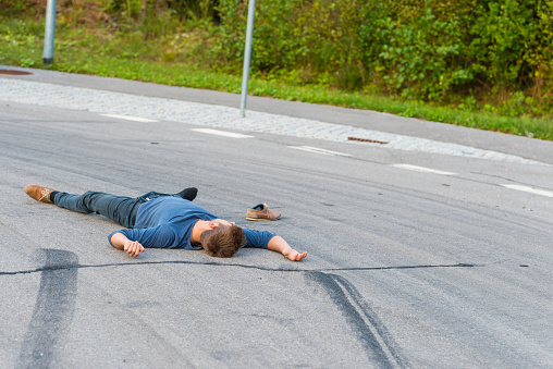 905971060 istock photo Traffic accident.Young man hit by a car 905971088