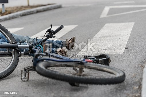 905971060istockphoto Traffic accident.Young man on bike hit by a car 650714360