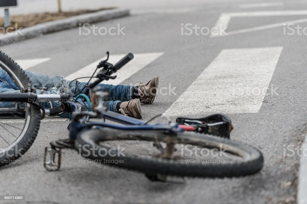 Traffic accident.Young man on bike hit by a car stock photo