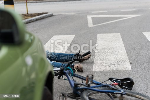 905971060istockphoto Traffic accident.Young man on bike hit by a car 650714366