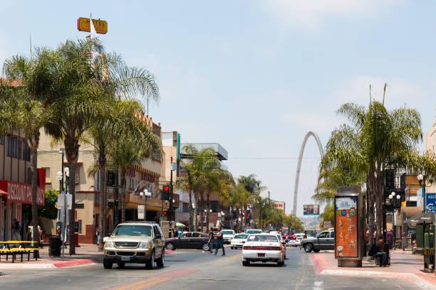 Traffic Along Avenida Revolucion with Monumental Arch in Tijuana, Mexico stock photo
