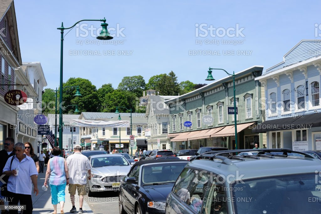 Traffic and crowd on West Main Street in downtown Mystic stock photo