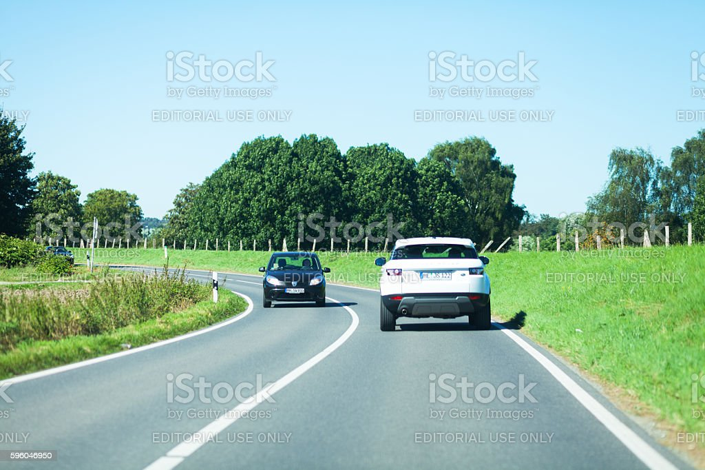 Traffic and driving in curve on road royalty-free stock photo