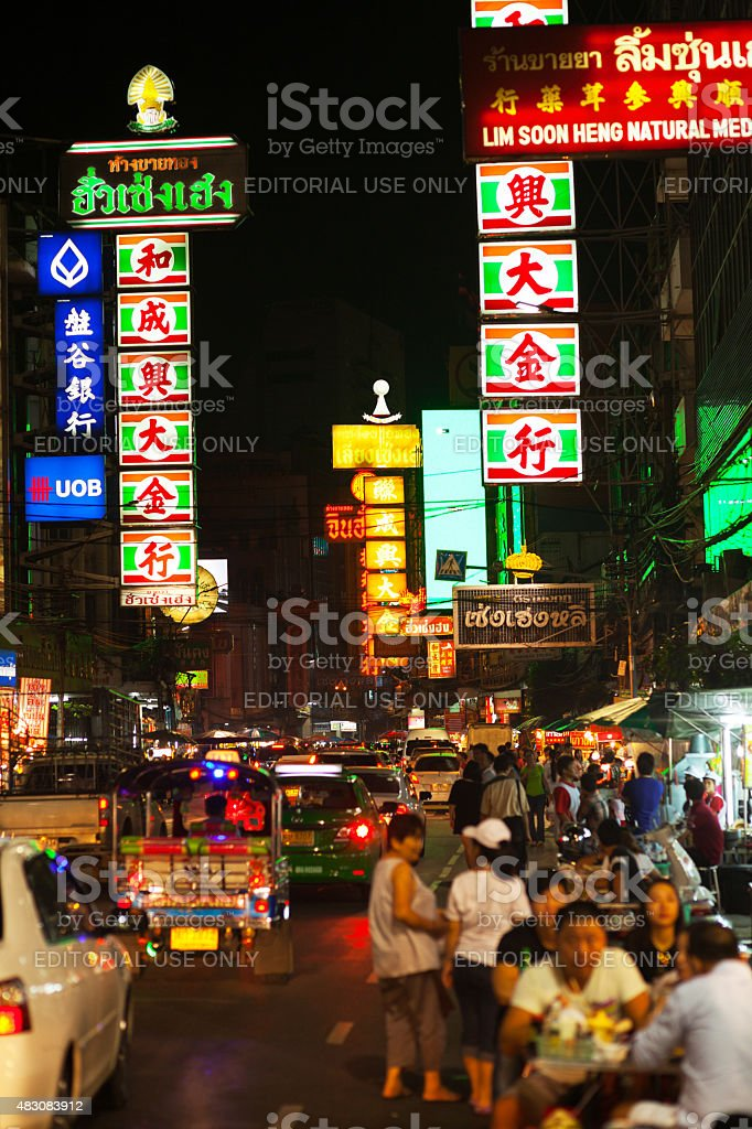 Traffic and eating people on Yaowarat Road at night stock photo