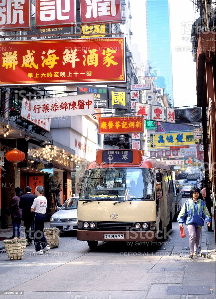 traffic and pedestrians on Connaught Road, Hong Kong royalty-free stock photo