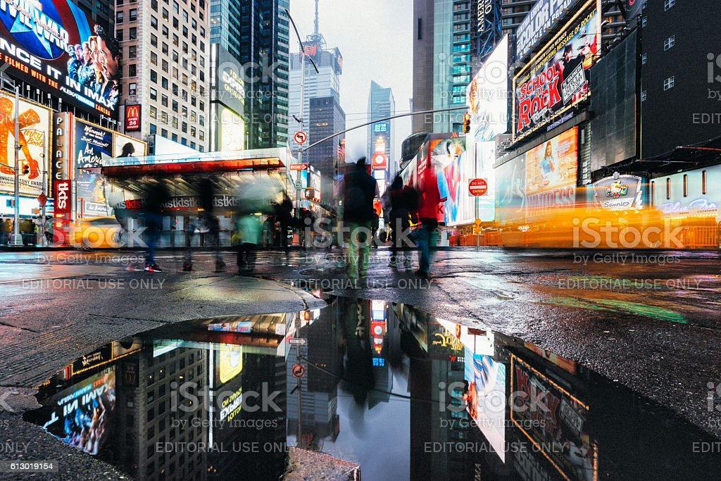 Traffic and people in Times Square - Rainy day stock photo
