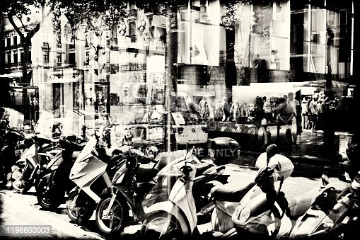 barcalona spain july 7 - 2015  next to las ramblas in city barcelona with traffic and shop windows in black and white barcelona city spain in double exposure