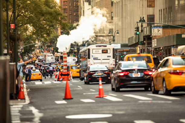Traffic and yellow cabs of downtown Manhattan New York City USA stock photo