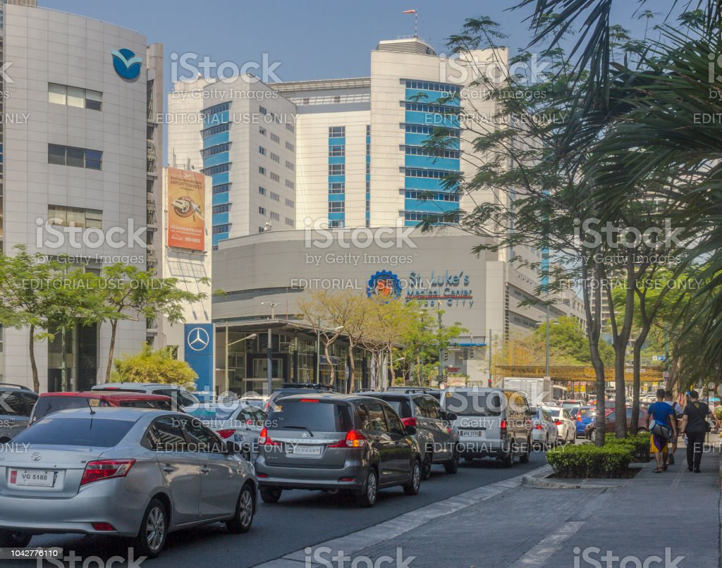 Traffic at BGC in Taguig City Manila, Philippines. St. Lukes Medical Center is also visible in the background. stock photo