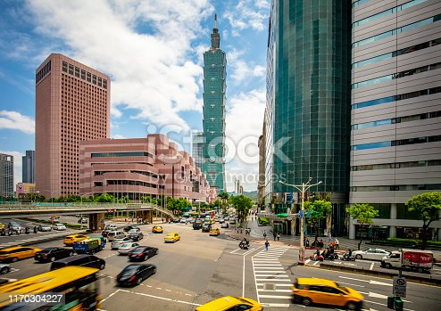 Long exposure image of traffic at centre of Taipei with 101 building in the background.