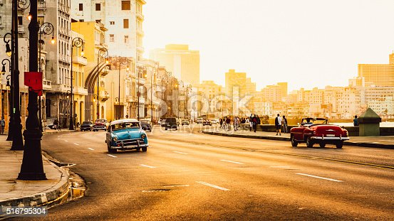 Traffic at Malecon road, Havana, Cuba, Latin America at sunset. Malecon (Avenida de Maceo) is 8 km (5 miles) starting from Havana Harbor in Old Havana and ending at Vedado.