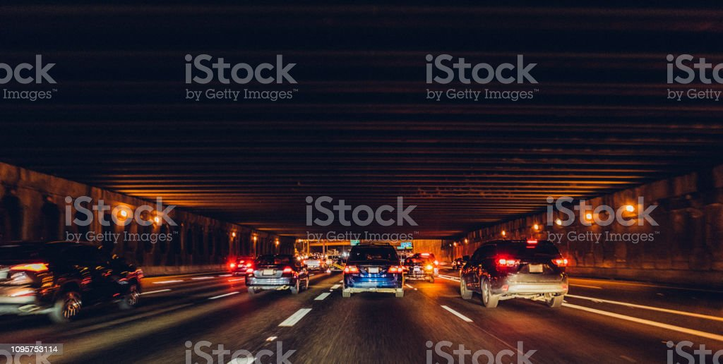 traffic at night going through and overpass stock photo