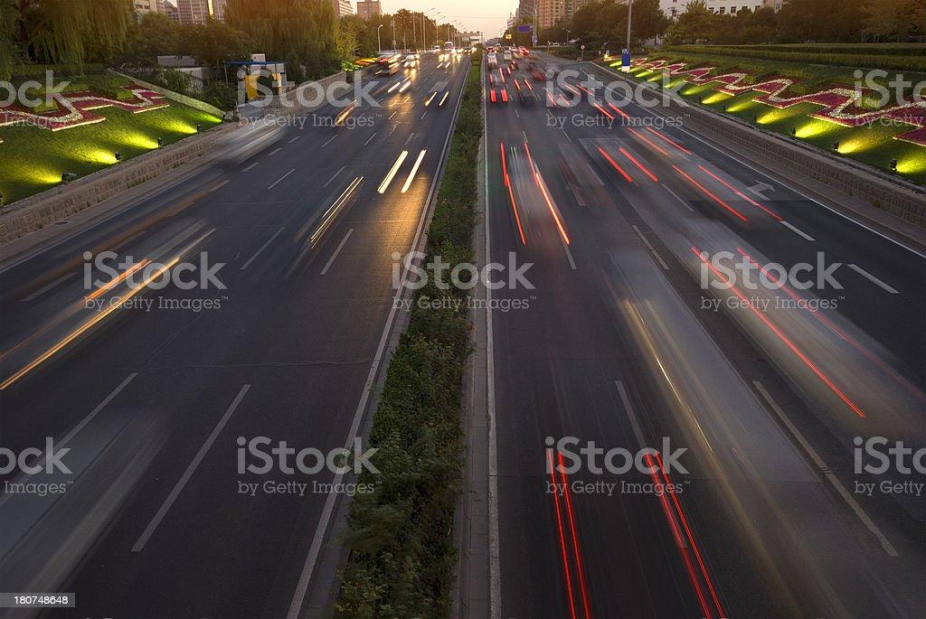 traffic at nightfall in modern city royalty-free stock photo