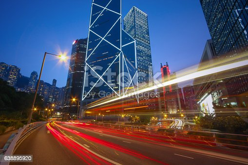 860696690 istock photo Traffic Car light trails on Cityscape, business buildings, Hong Kong 638895920