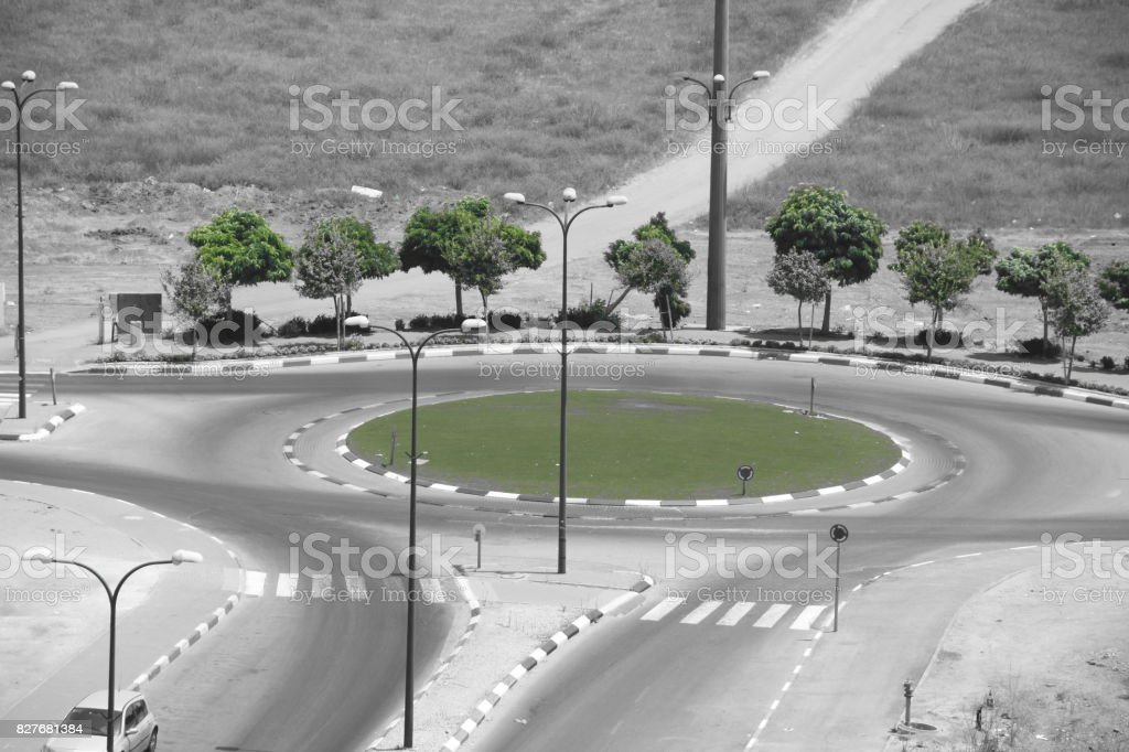 traffic circle on the road stock photo