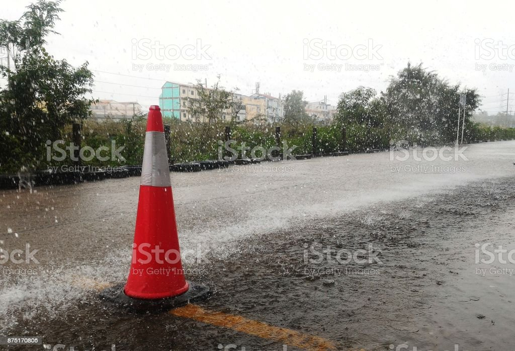 traffic cone in raining for background stock photo