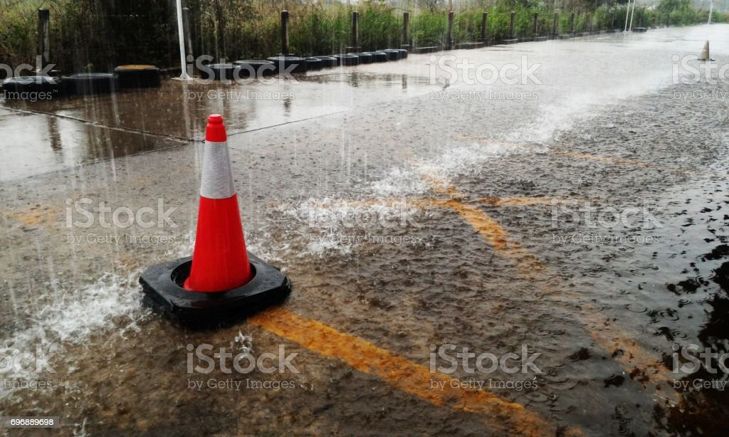 traffic cone in raining stock photo