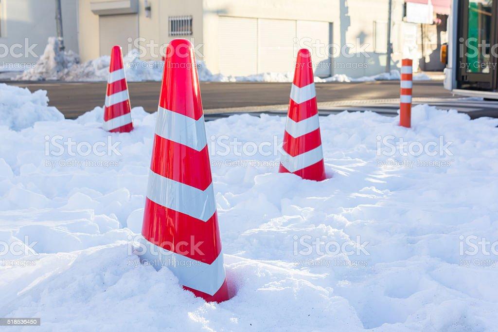 traffic cone in winter stock photo