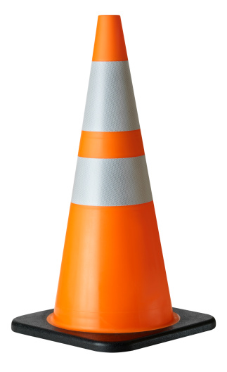 Bright orange construction of traffic cone with reflective stripes. Isolated on white background.Studio shot with medium format camera and digital back.