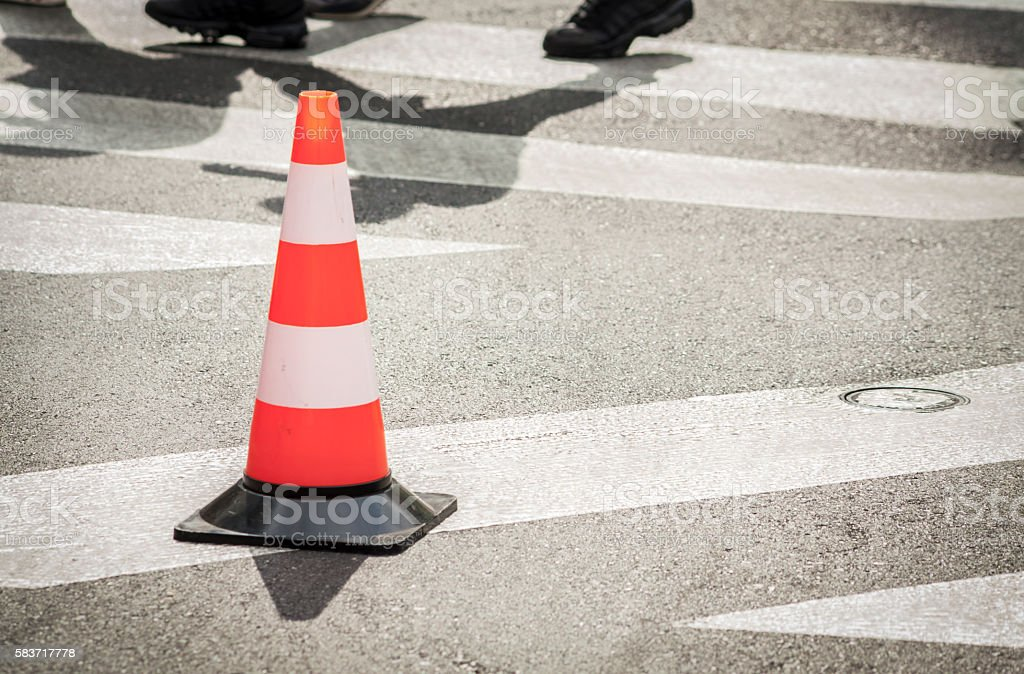 Traffic Cone On Asphalt With Shadows stock photo