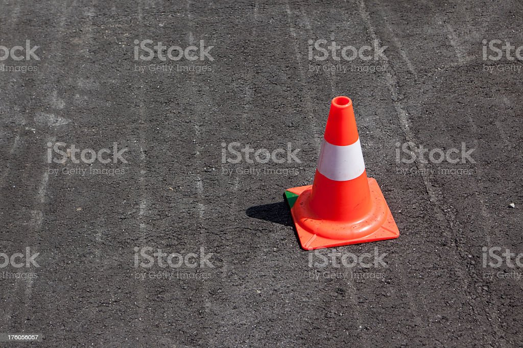 Traffic cone on road with copy space.
