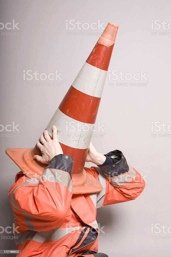 Traffic cone over the head royalty-free stock photo