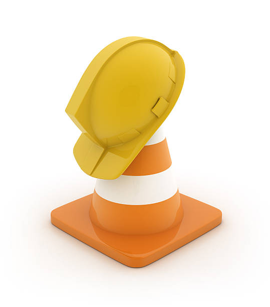 Traffic cone with hard hat stock photo