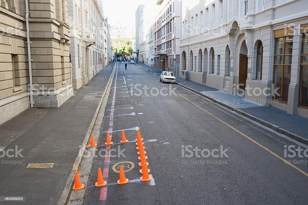 Traffic cones blocking off part of urban street stock photo
