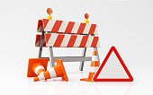 Orange colored traffic cones construction barrier and a red triangle shaped road sign on white background. Horizontal composition with  copy space.