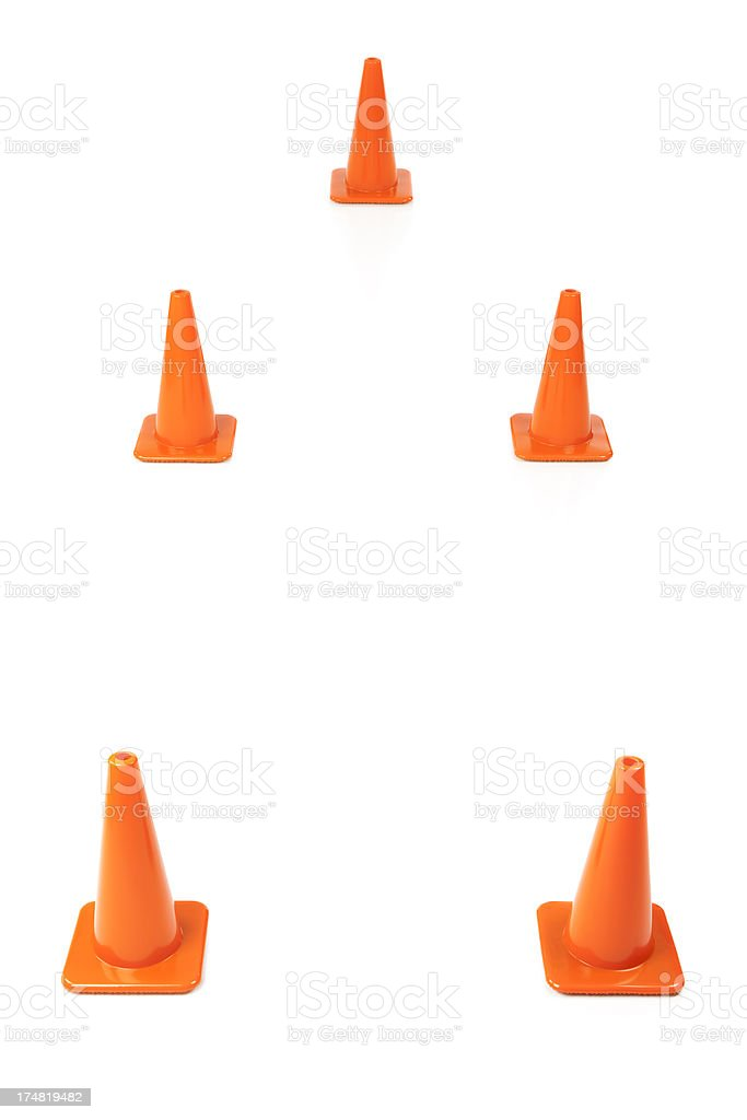 Orange traffic cones arranged in the pattern for a driving...